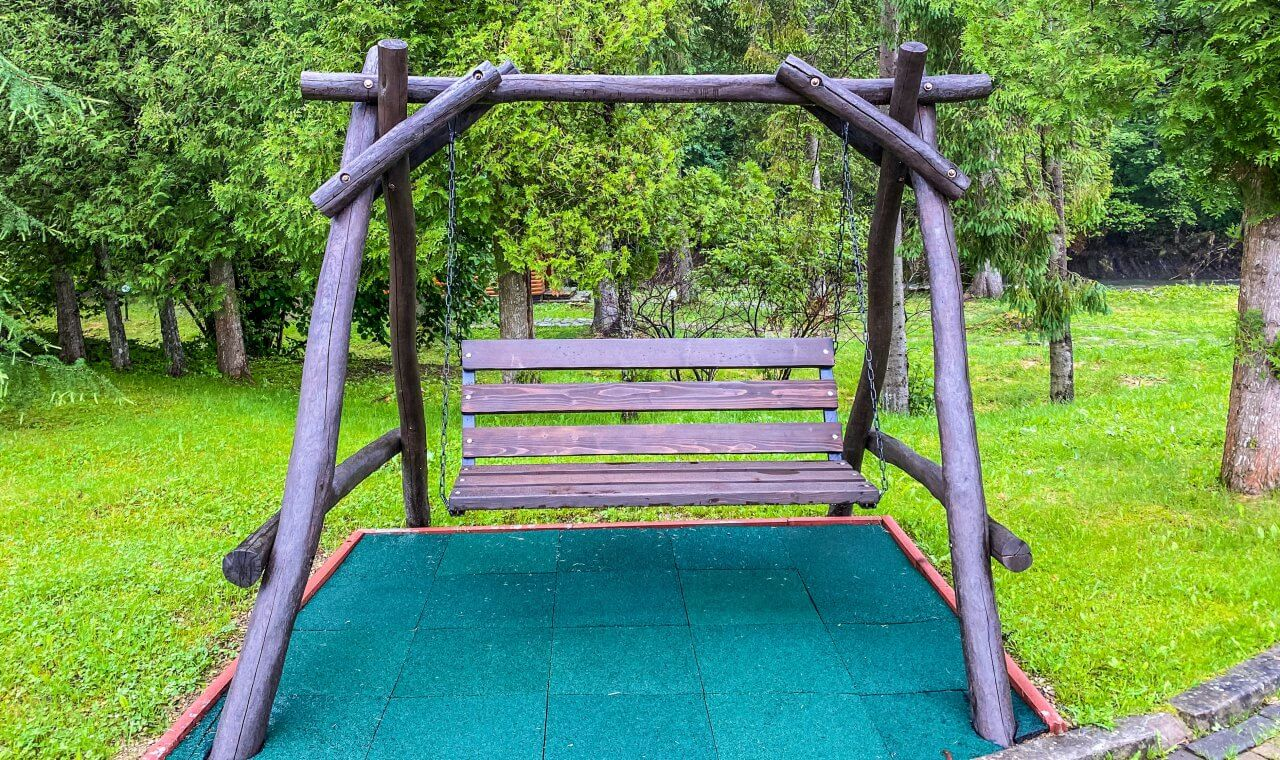 wooden swing in the fresh air among